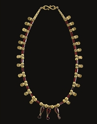 A GREEK GOLD AND GARNET BEAD N
