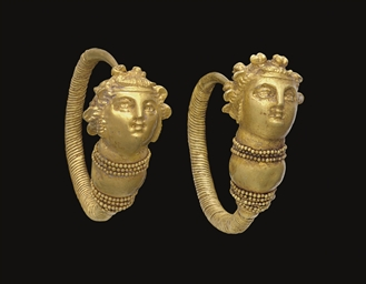 A PAIR OF GREEK GOLD MAENAD EA