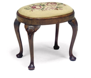 A CARVED WALNUT STOOL