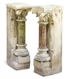 A PAIR OF CARVED STONE ARCHITE