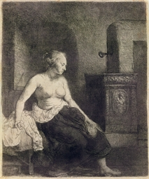 A Woman sitting half-dressed b