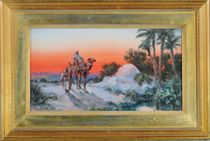Two Arabs and a camel on a desert path at sunset