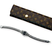 """A STAINLESS STEEL AND DIAMOND """"TAMBOUR"""" WATCH, BY LOUIS VUITTON"""