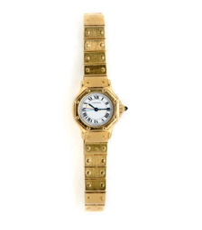 CARTIER. A LADY'S 18K GOLD TON
