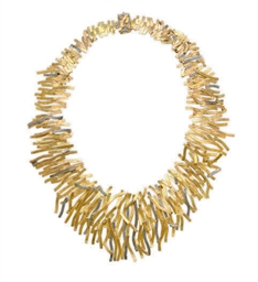 AN 18K BI-COLORED GOLD NECKLAC