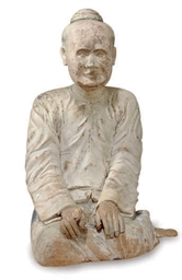 AN ASIAN CARVED AND POLYCHROME