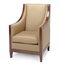 A MAHOGANY AND TAUPE UPHOLSTER
