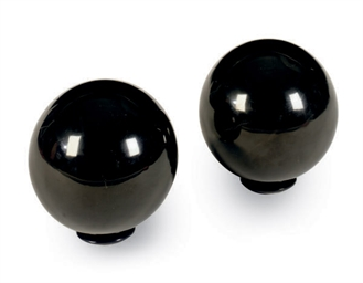 A PAIR OF OBSIDIAN STONE TABLE
