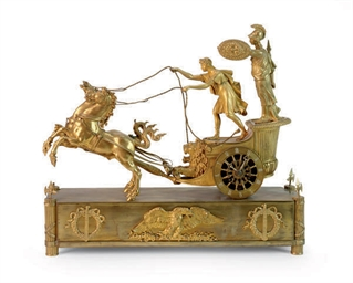 AN EMPIRE ORMOLU CHARIOT CLOCK