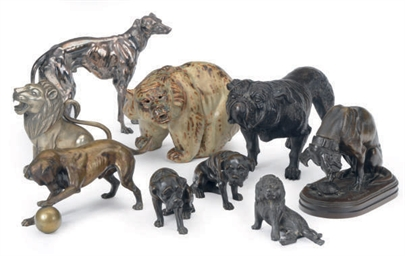 A GROUP OF NINE FIGURES OF DOG