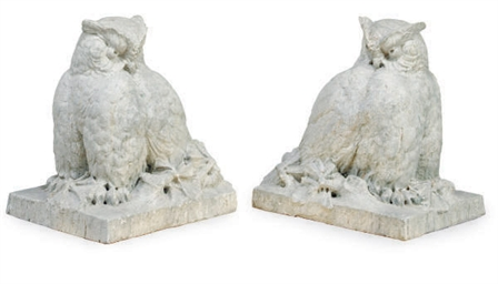 A PAIR OF CARVED GREEN STONE F