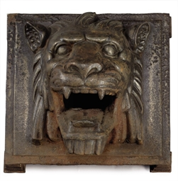 A CAST IRON LION-MASK ARCHITEC