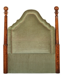 A WALNUT AND UPHOLSTERED HEADB