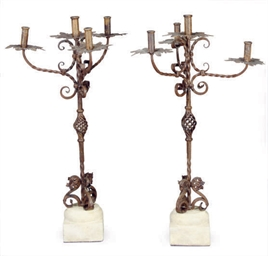 A PAIR OF WROUGHT IRON FOUR-LI