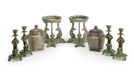 A GROUP OF EIGHT METAL TABLE A