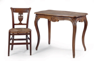 A FRENCH WALNUT WRITING TABLE,