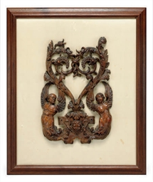 A CARVED WALNUT RELIEF,