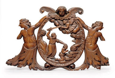 A CARVED WALNUT RELIEF OF ABRA