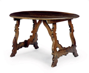 A SPANISH WALNUT OVAL TRESTLE