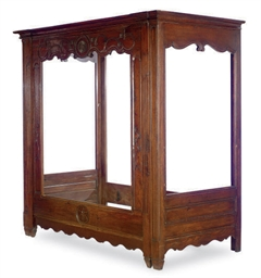 A FRENCH OAK ALCOVE BED,