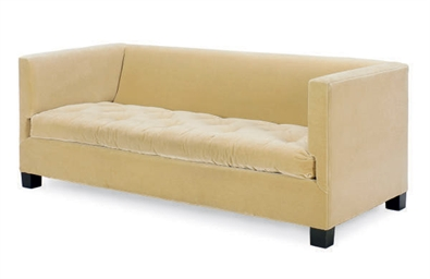 A BEIGE PLUSH UPHOLSTERED SOFA