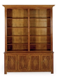 A CONTINENTAL WALNUT BOOKCASE