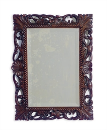 A CARVED WALNUT MIRROR,