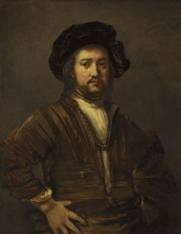 Portrait of a man with arms akimbo