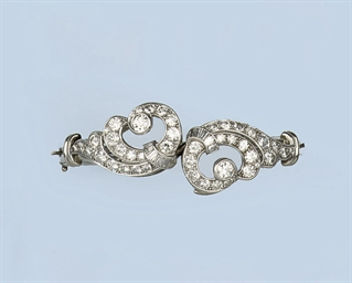 A DIAMOND BANGLE/PAIR OF CLIPS
