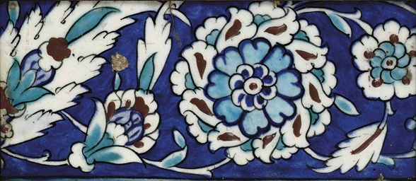 An Iznik polychrome framed pot
