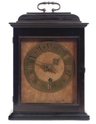 AN EBONIZED AND BRASS TIMEPIEC