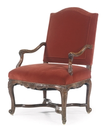 A REGENCE WALNUT OPEN ARMCHAIR