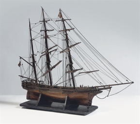 A FULLY RIGGED WOODEN MODEL OF