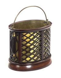 AN ENGLISH MAHOGANY TEA STOVE