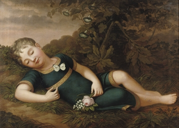 A sleeping child on a forest f