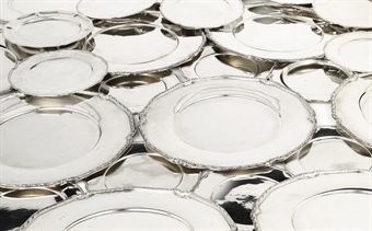 A set of twelve Mexican silver dinner plates, twelve side-plates and three side plates
