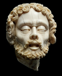 A CARVED IVORY HEAD OF ST JOHN