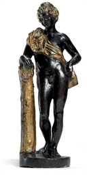 A PARCEL-GILT BRONZE FIGURE OF