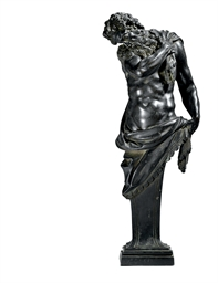 A BRONZE CARYATID FIGURE OF A