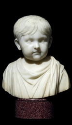 A CARVED MARBLE BUST OF THE IN
