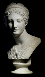 A CARVED MARBLE BUST OF A MUSE