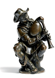 A BRONZE FIGURE OF A BAGPIPER