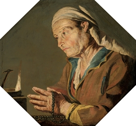 An old lady telling beads by c