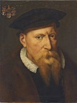 Portrait of a Robert de Croÿ, Bishop of Cambrai (d. 1556), bust-length, in a black hat and doublet, with a lace collar and a fur mantle