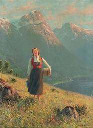 A young girl by a fjord