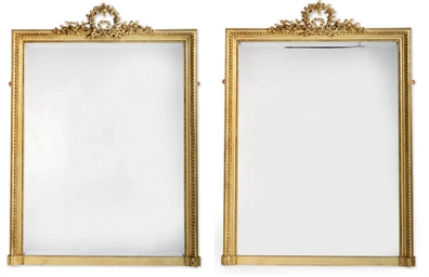 A PAIR OF GILT FRAMED OVERMANT