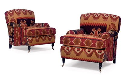 A PAIR OF KILIM-COVERED ARMCHA
