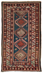 An antique Kazak rug