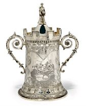 A VICTORIAN SILVER CHESS TROPHY CUP IN THE FORM OF A ROOK WITH FOLIATE HANDLES