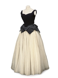 A BALL GOWN OF BLACK VELVET AN